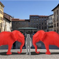 Due elefanti rossi a Pavia. Installazione di Cracking Art